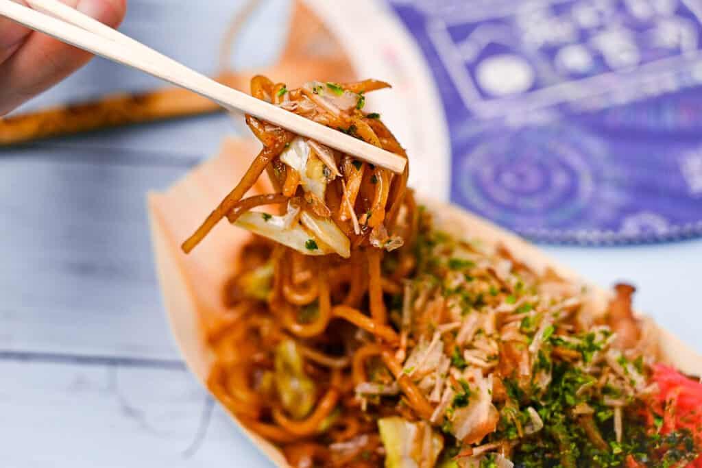 Japanese yakisoba noodles held with chopsticks
