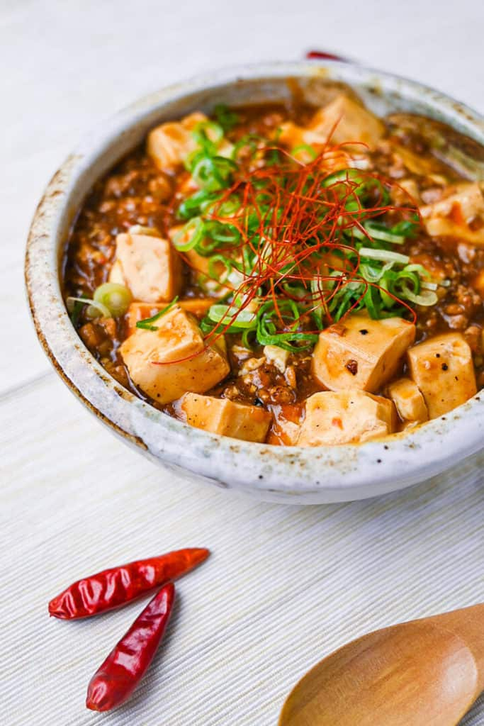 Mabo tofu topped with spring onion and chili threads