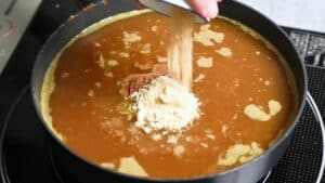Adding more spices to the curry roux
