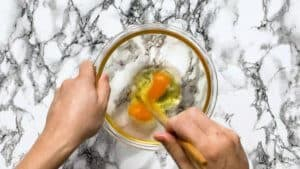 mixing two eggs