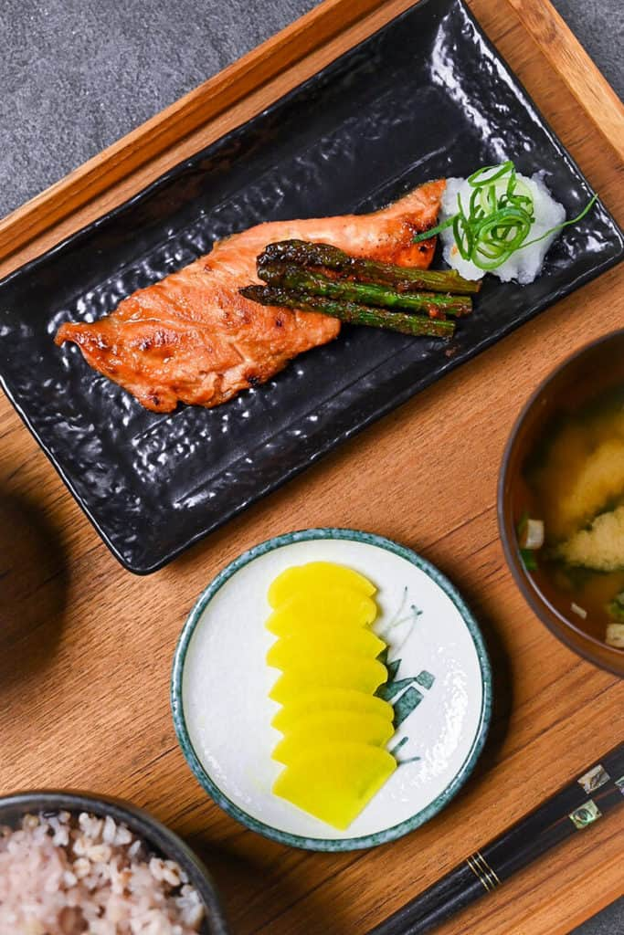 miso salmon served as a teishoku main dish next to yellow pickled radish and miso soup