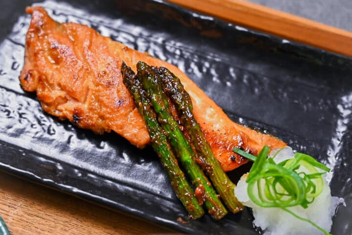 miso salmon served with asparagus and grated daikon