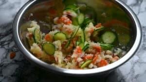 Mixing cucumber to potato salad