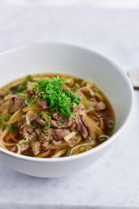Beef Udon sprinkled with spring onions