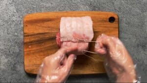 rolling and tying the chashu