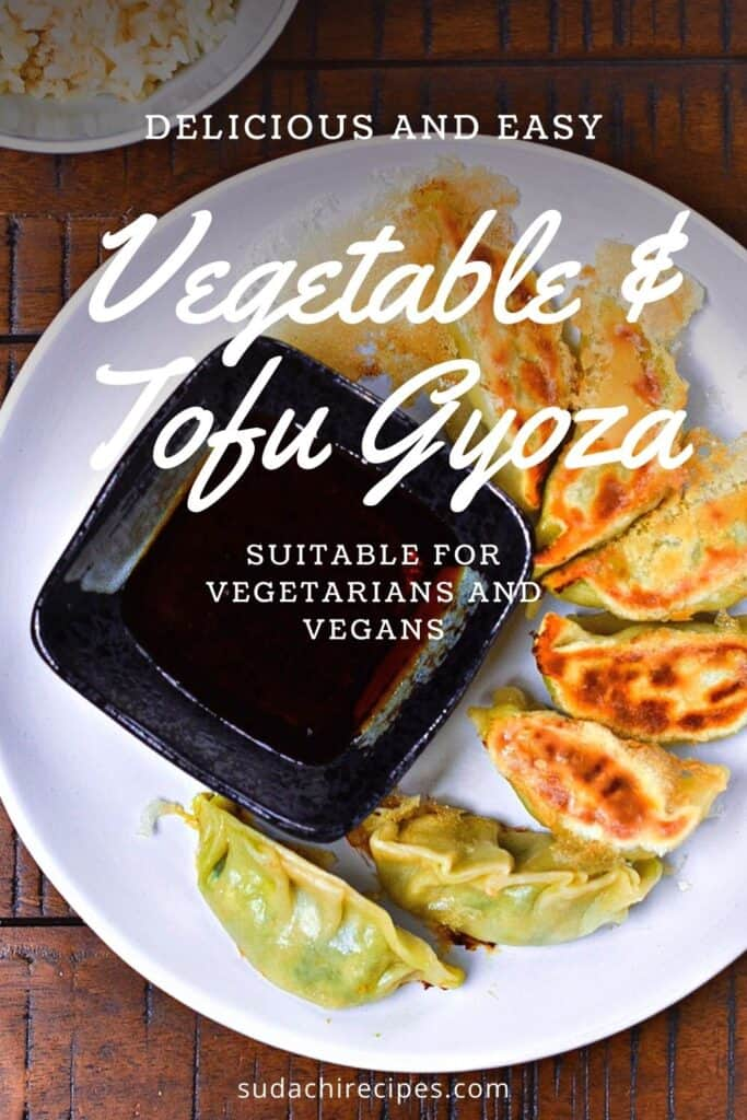 Vegetable and tofu gyoza arranged around a square black dish of dipping sauce