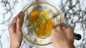 whisking 3 eggs in a bowl