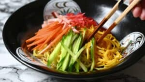 Complete Hiyashi Chuka topped with pickled ginger