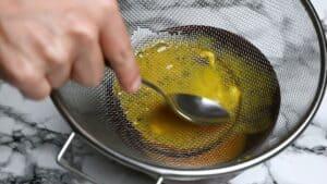 Passing egg through sieve