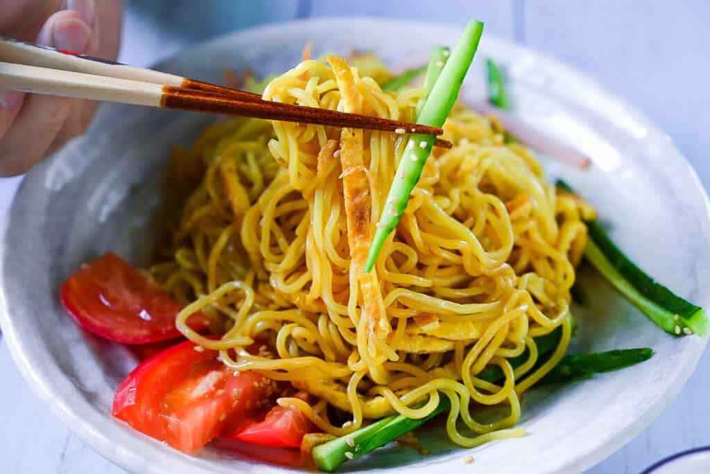mixed hiyashi chuka with chopsticks