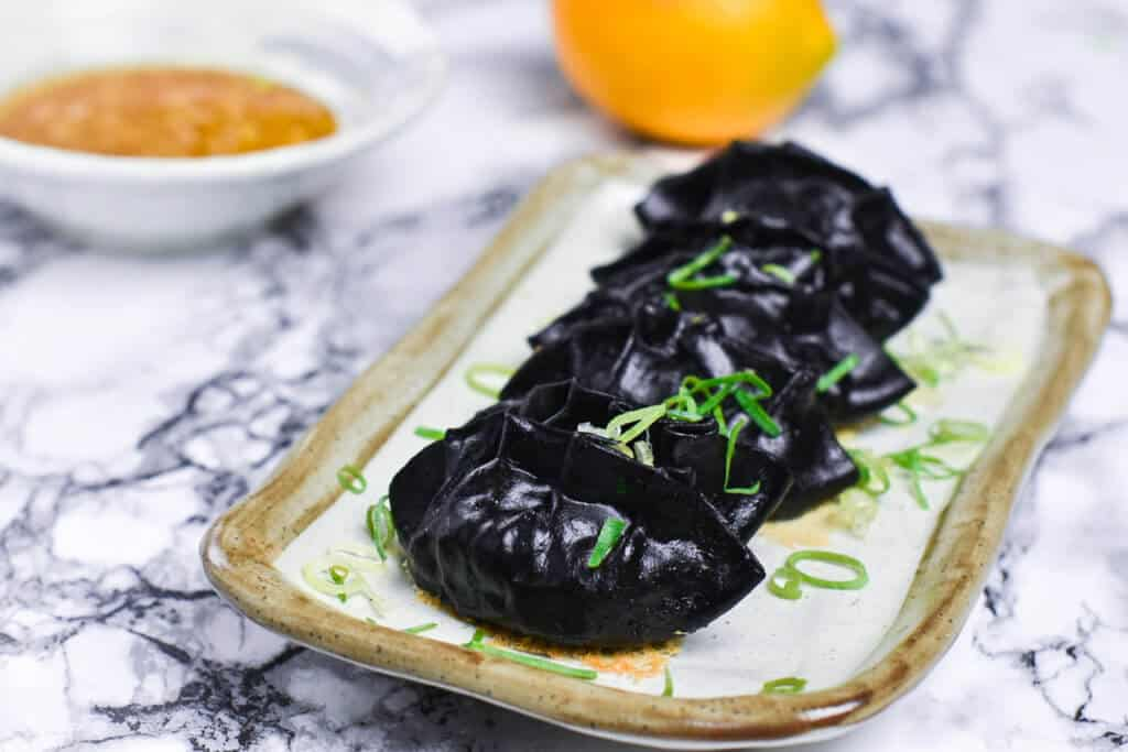 squid ink gyoza side view