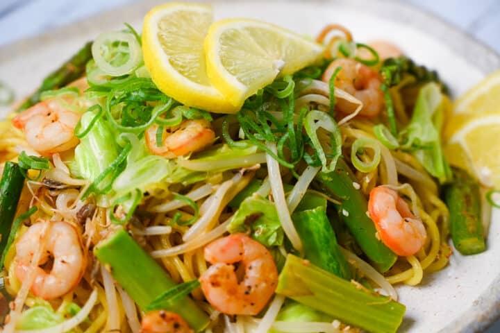 Shio Lemon yakisoba with shrimp and asparagus close up