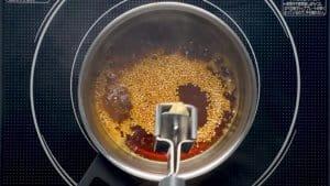 adding garlic to the sauce
