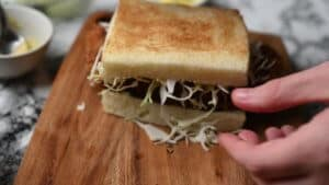add shredded cabbage and bread katsu sando