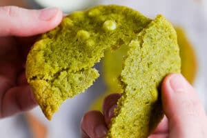 breaking matcha white chocolate chip cookie in half