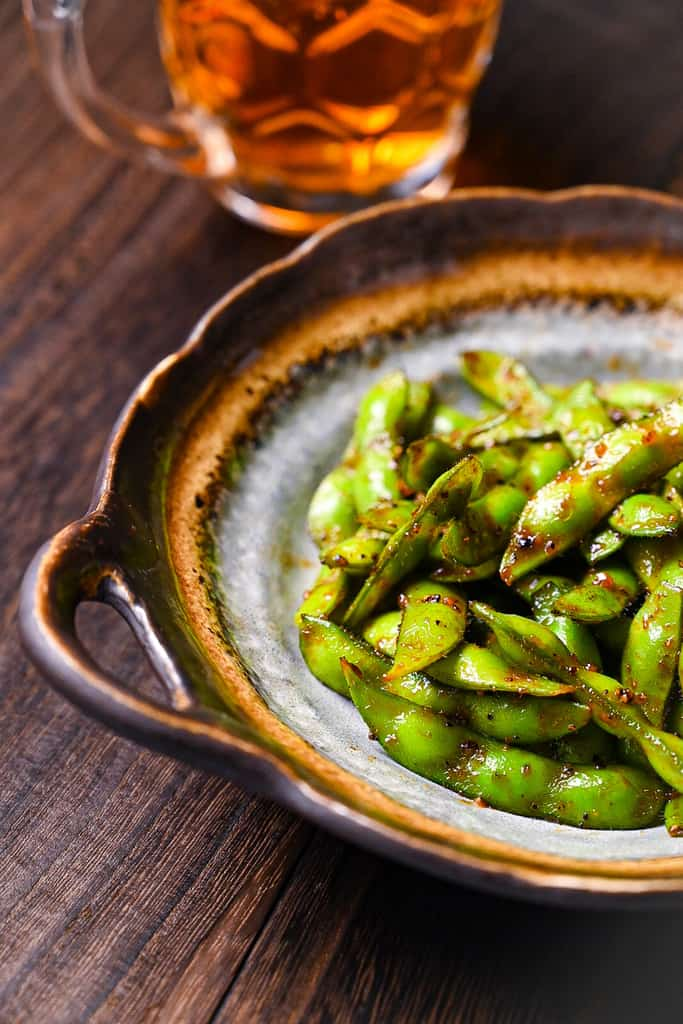 edamame side view with beer