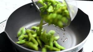 add edamame to the frying pan