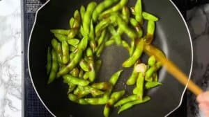 add oyster sauce and garlic paste to edamame