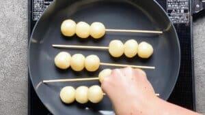heat frying pan and place the dango inside