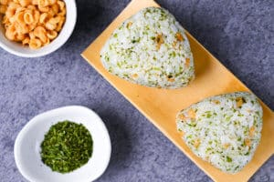 two devil's onigiri rice balls with tenkasu and aonori