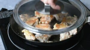 flip the chicken and place a lid on top