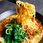 tantan ramen noodles held by chopsticks