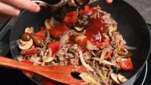 adding ketchup to the pan
