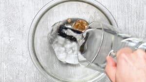 Add 600ml water to a bowl with 1 dried shiitake mushroom and 1 sheet of kombu