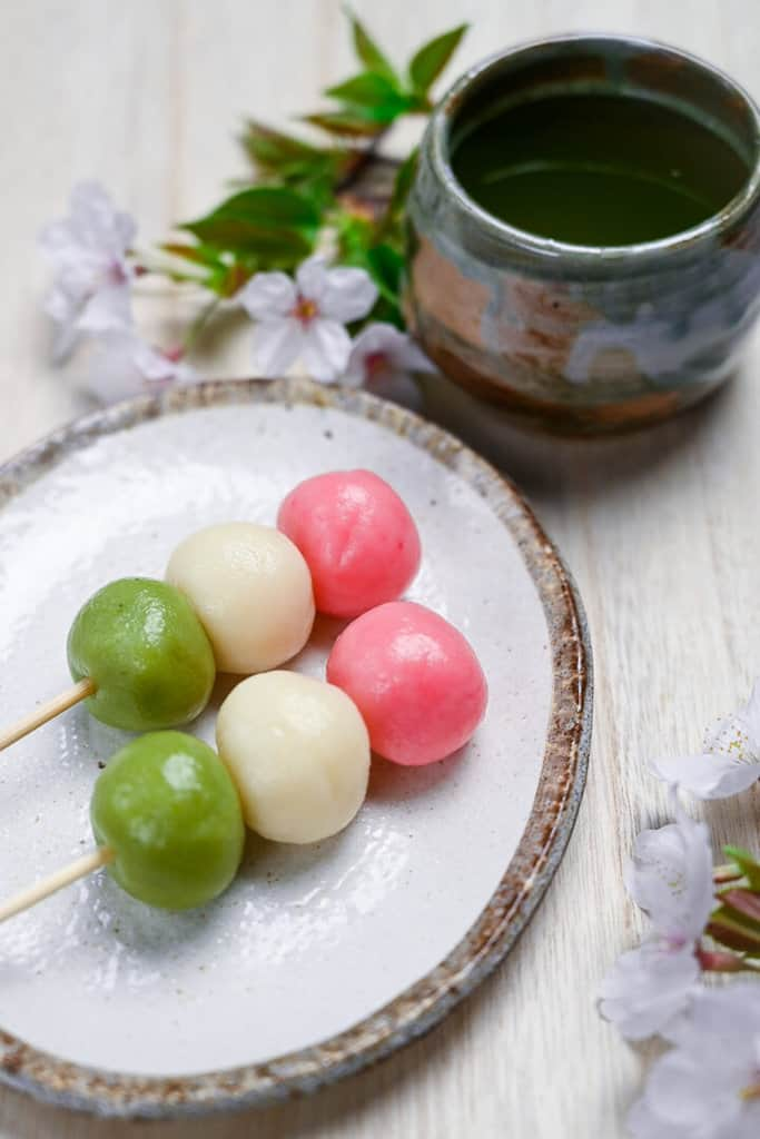hanami dango with cherry blossoms and green tea