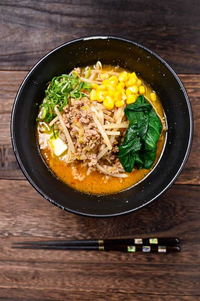Miso ramen with butter topped with pork mince, spinach, sweet corn, beansprout and spring onion