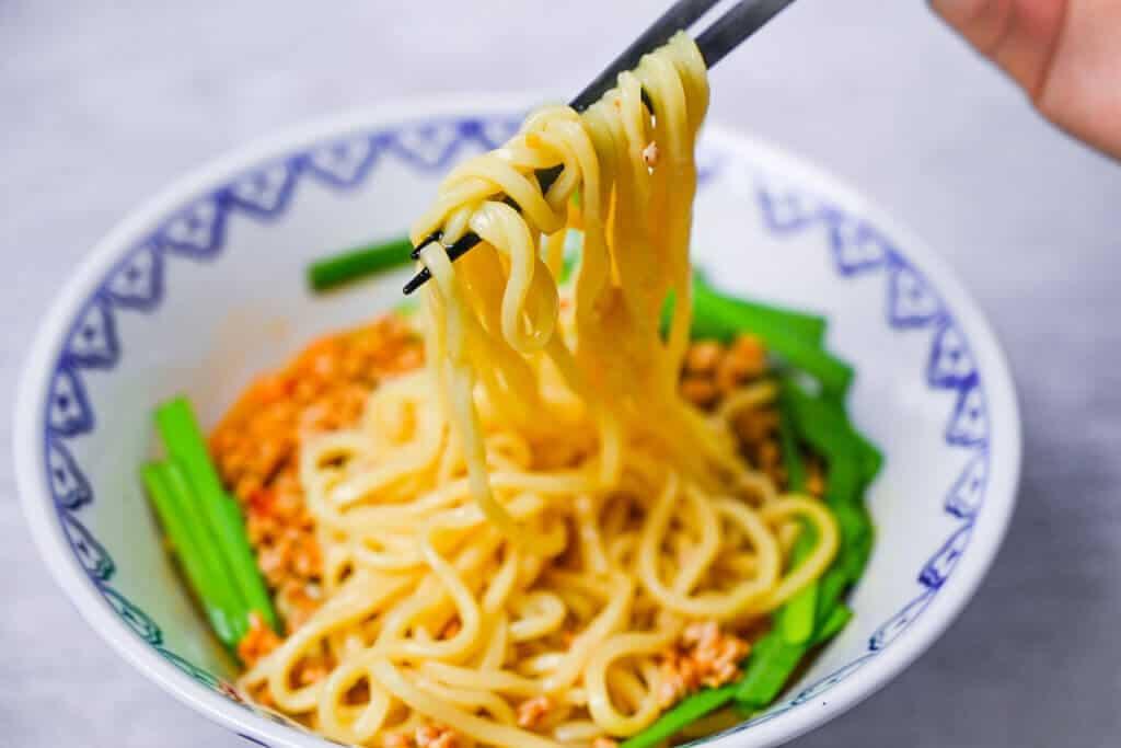 Taiwan ramen lifted with chopsticks