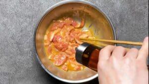 Chinjao Rosu: Adding sesame oil to pork egg mixture