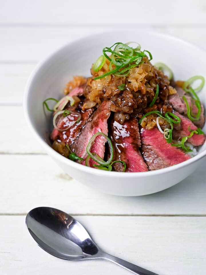Chaliapin Steak Don served in a white bowl with silver spoon