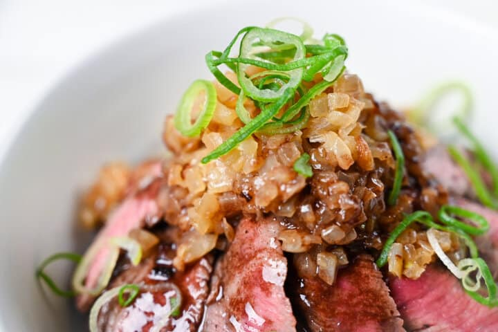 close up of fried onions served on top of Chaliapin steak don