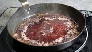 bubbling red wine sauce