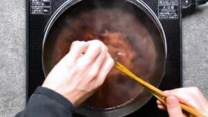 adding corn starch slurry to the sauce
