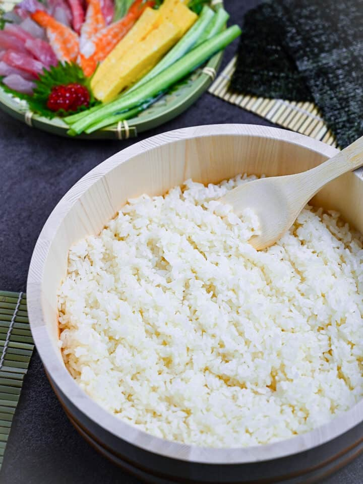 a close up of sushi rice on a rice paddle