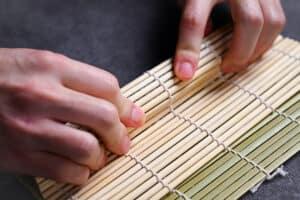 rolling kappa maki using a bamboo rolling mat