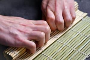 rolling kappa maki into a cube shape