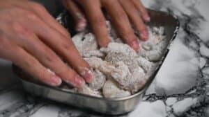 Coating the shrimp in cornstarch