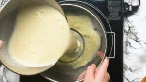 Pouring the ice cream mixture through a sieve
