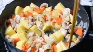 Adding potato, carrots and tsuyu sauce to the pot