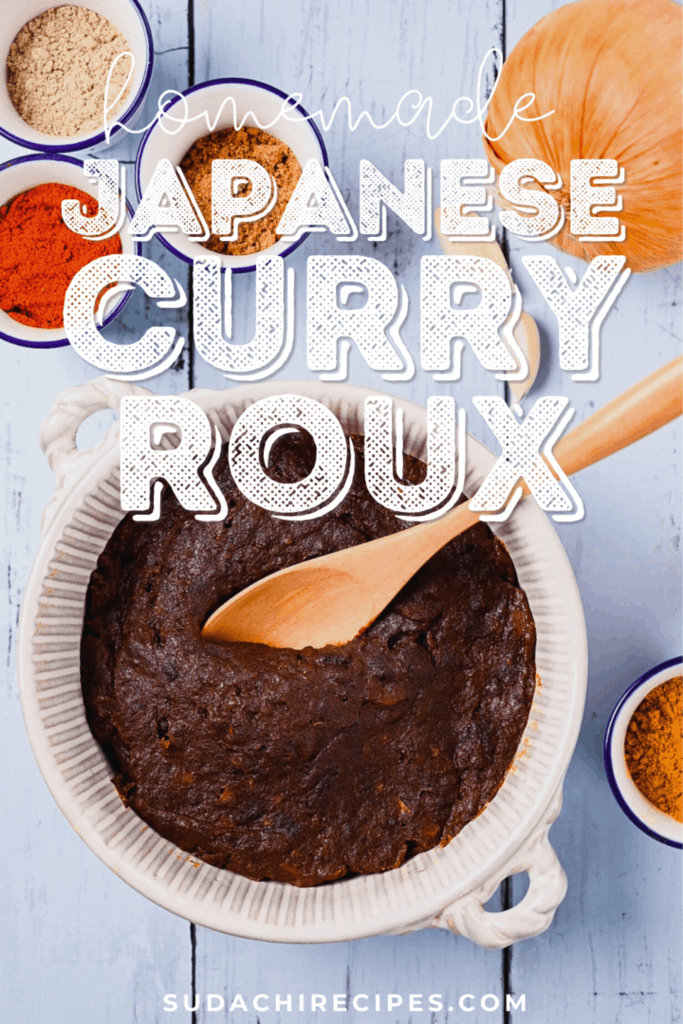Homemade Japanese curry roux in a white dish with spices and onion on a blue wood effect background