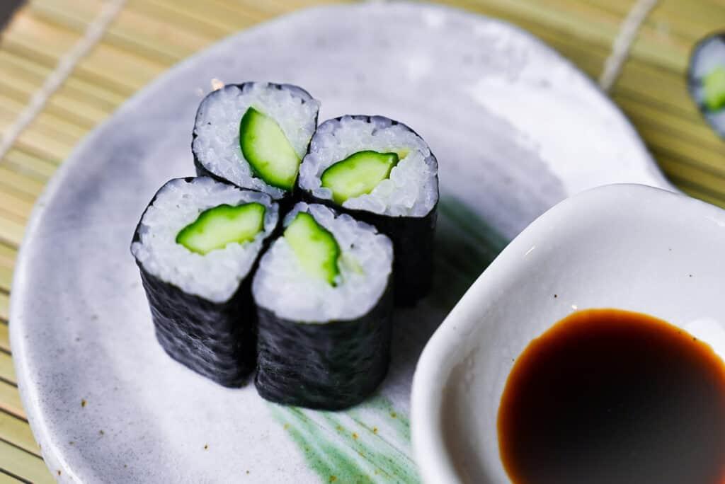 Four kappa maki sushi rolls on a plate