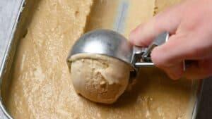 scooping hojicha ice cream with ice cream scoop