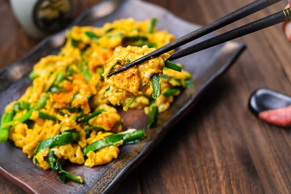 Niratama garlic chive and egg lifted with black chopsticks